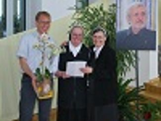 Caritas-Ehrennadel in Gold für Sr. Hildegard Hilkmann